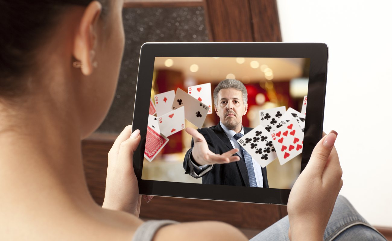 Woman playing live online casino on her tablet