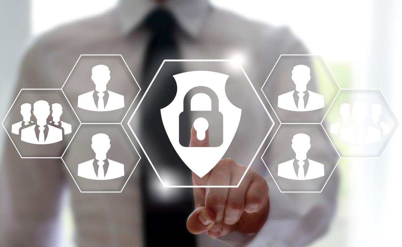 Businessman presses shield lock on virtual screen