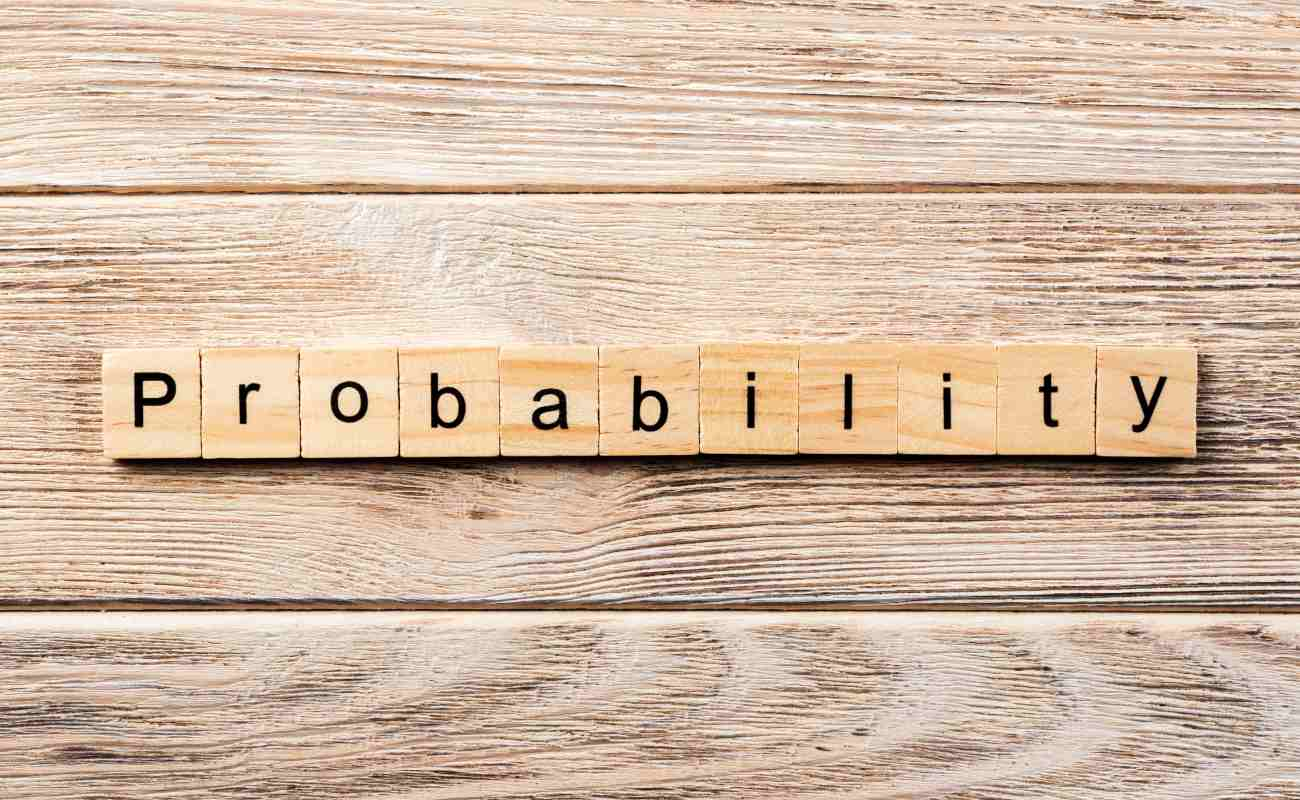 The word Probability spelled out on Scrabble tiles.