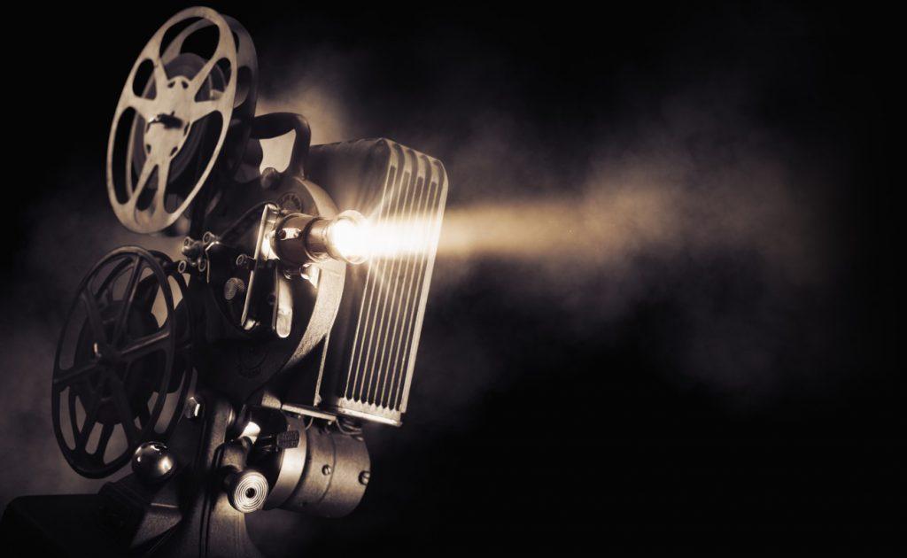 Movie Projector projecting a movie in the dark