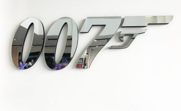 007 mirror on display on a wall