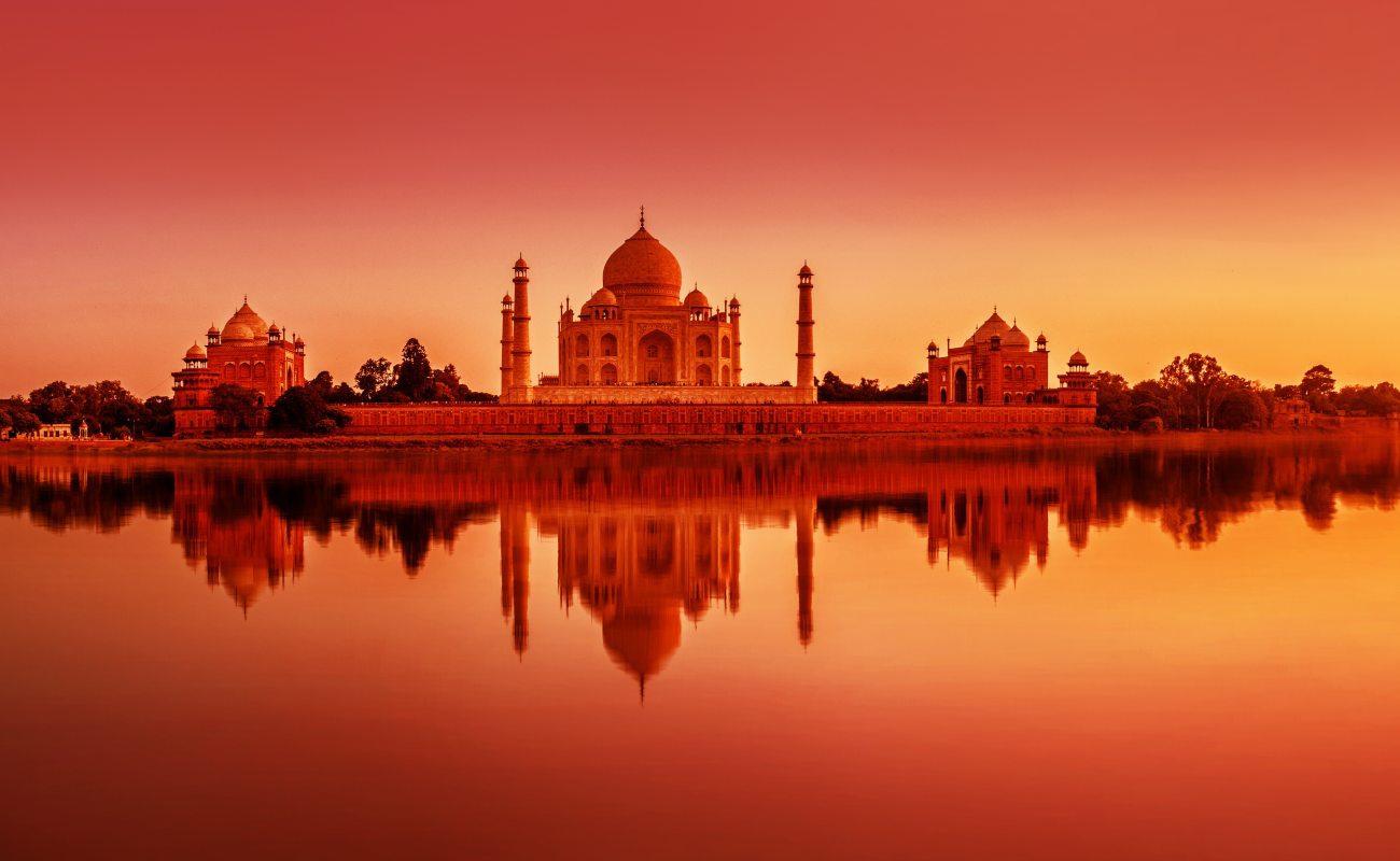 Panoramic view of Taj Mahal during sunset reflected in Yamuna river