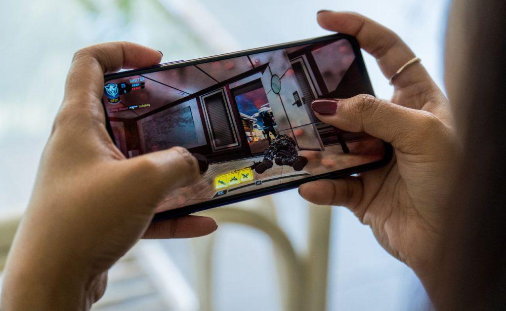 Women hands doing online gaming on her mobile