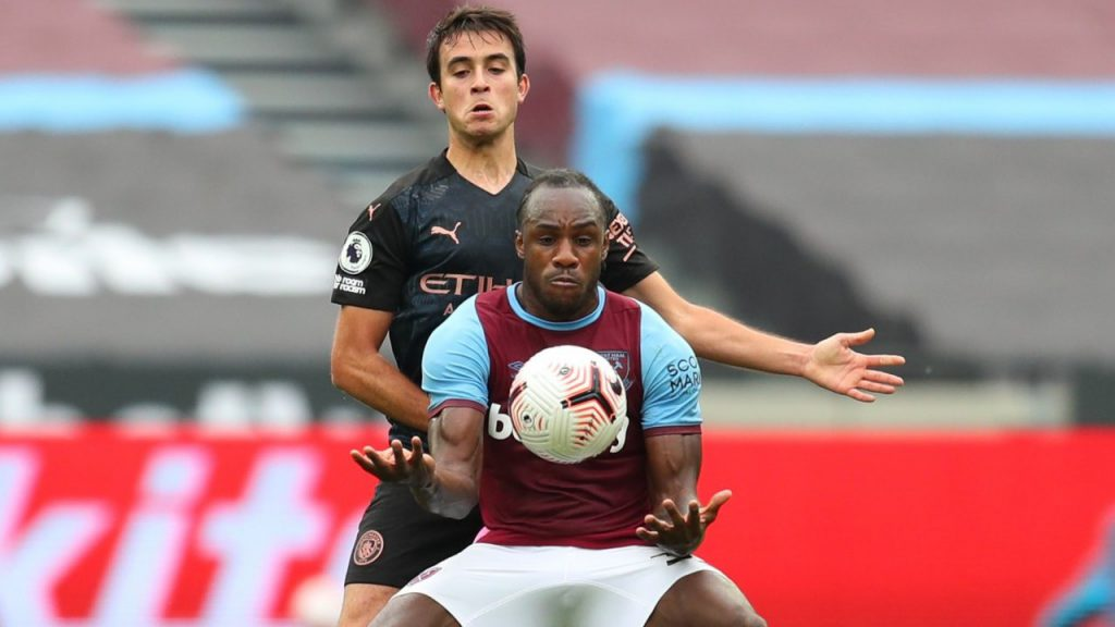 West Ham striker Michail Antonio shields the ball from a Manchester City player in the Premier League
