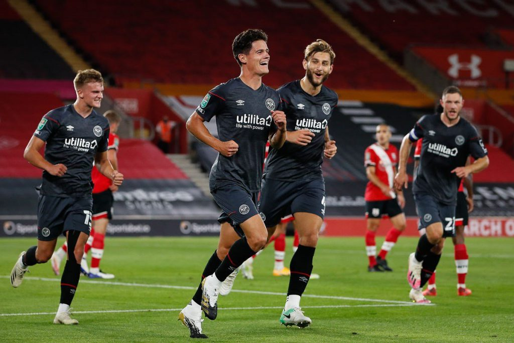 Christian Norgaard celebrates with Brentford teammates after scoring against Southampton