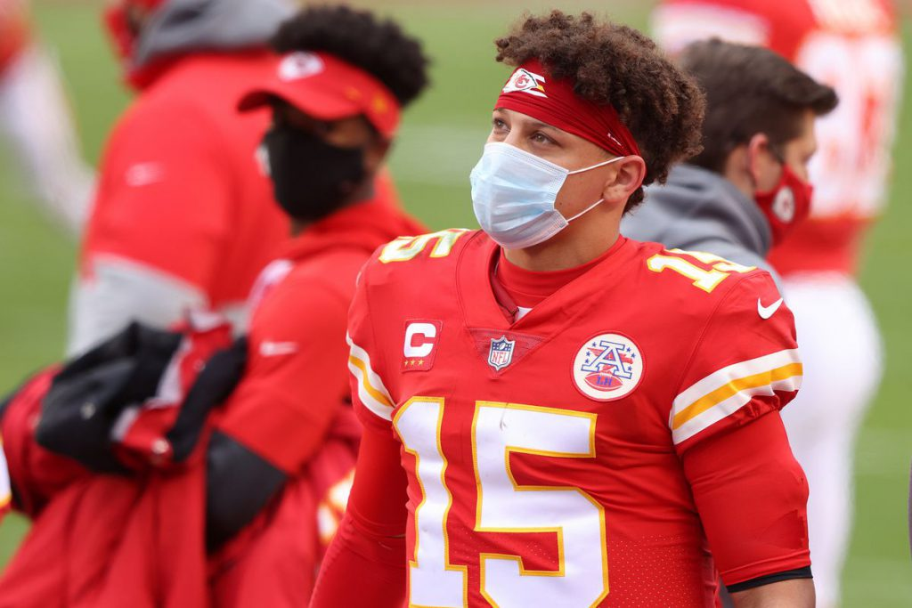 Kansas City Chiefs Quarterback Patrick Mahomes watches on while obeying COVID-19 protocol