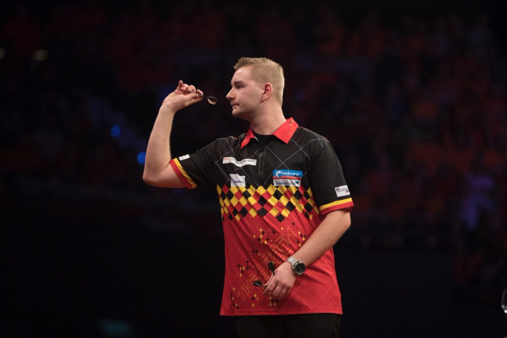 Belgian darts player Dimitri Van Den Bergh lining up a dart